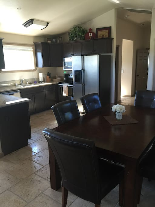 Spacious kitchen with granite countertops and table seating for 6