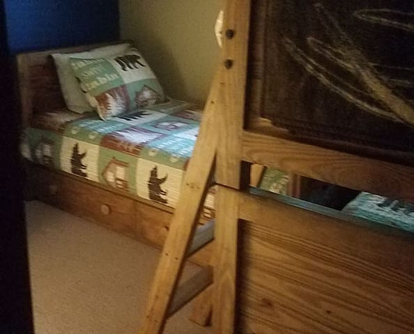 First floor bunk room . Three bunks and a pull out trundle