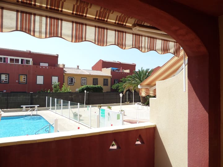 Apartment with balcony and swimming pool