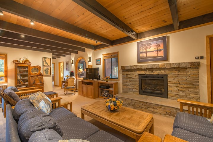 Large family room with gas fireplace & flat screen TV