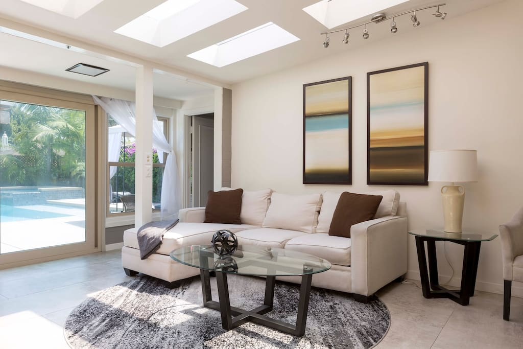 Lounge in a dramatic sky lit sunken entertainment area. The house is served with high speed FiOS wifi, DirecTV w premium channels, and AppleTV for all your connectivity needs.