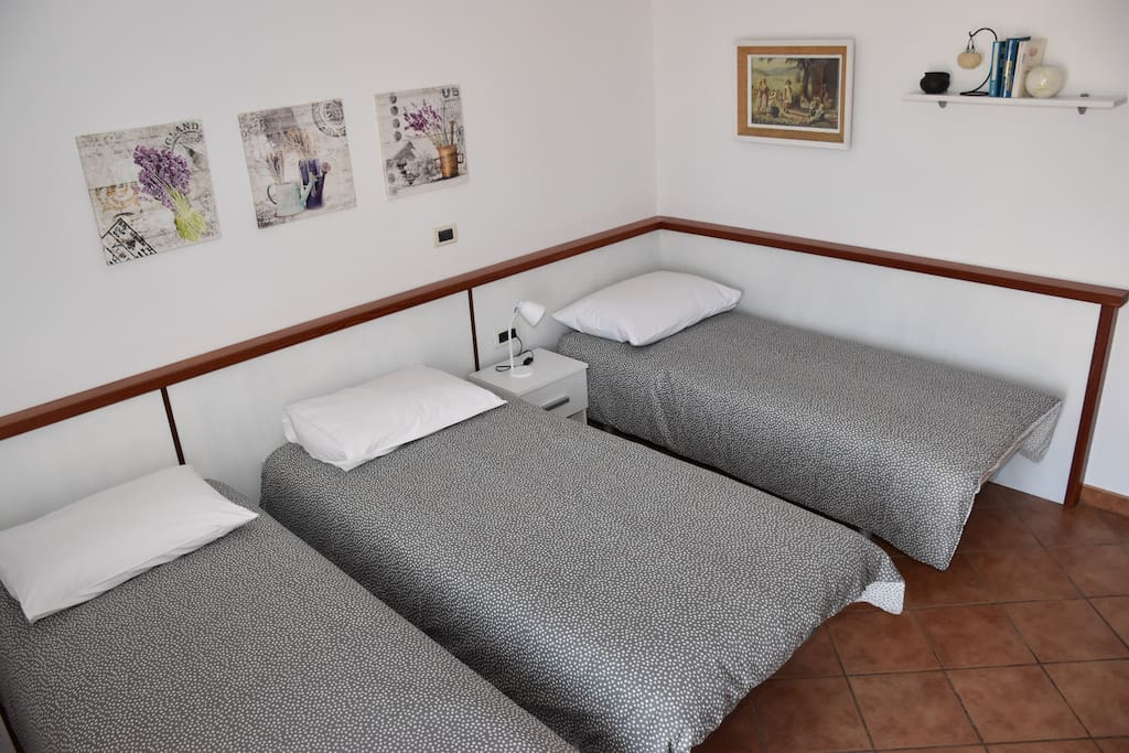 The second bedroom with three beds...
