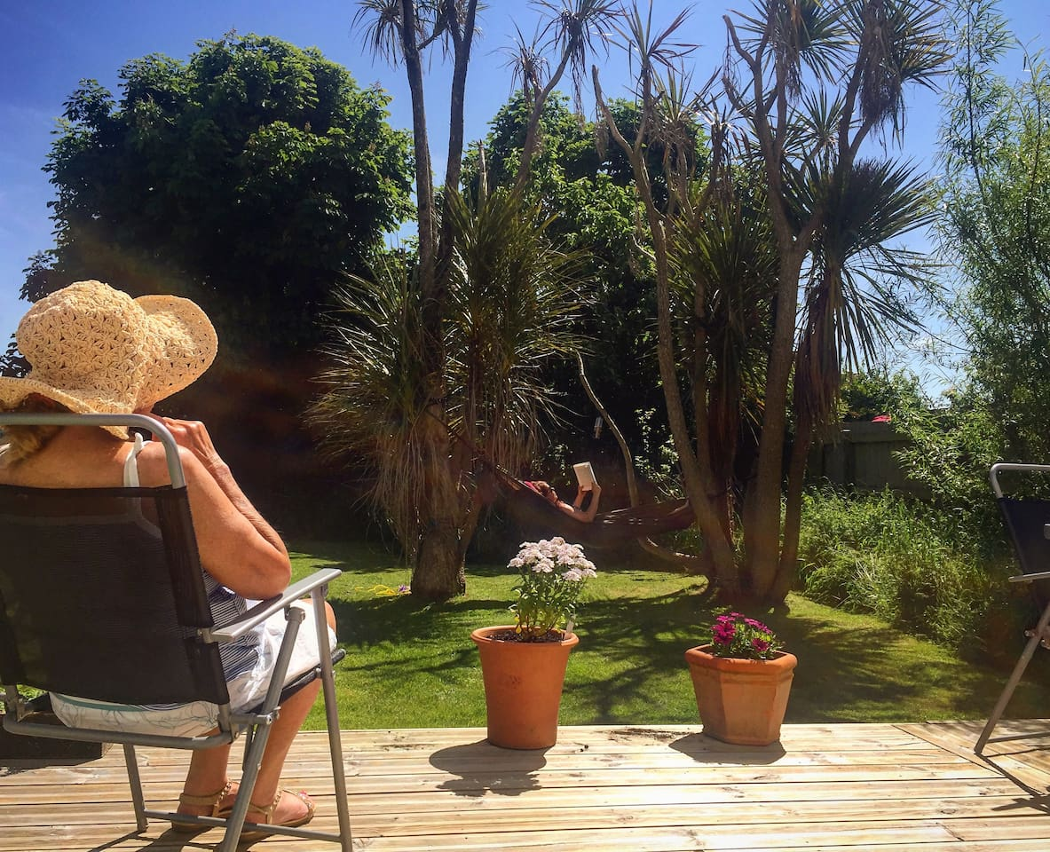Enjoy our mid summer garden either on the decking or in the hammock.