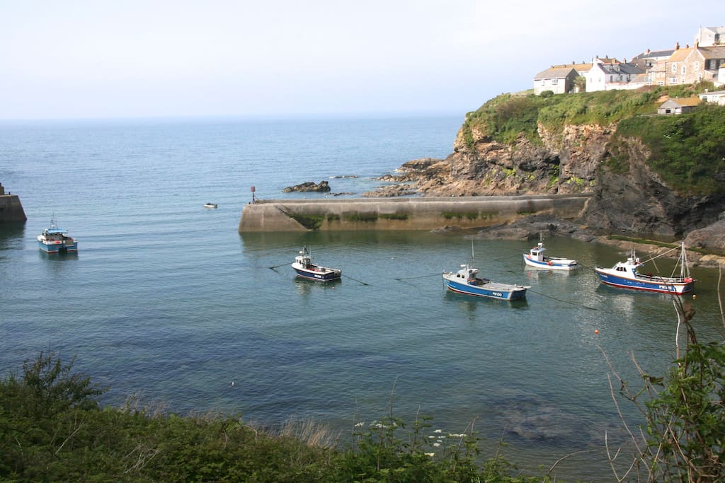 Port Isaac.famous film setting of Doc Martin also home of Fishermen's Friends.  Working harbour for local fishermen and traditional cottages