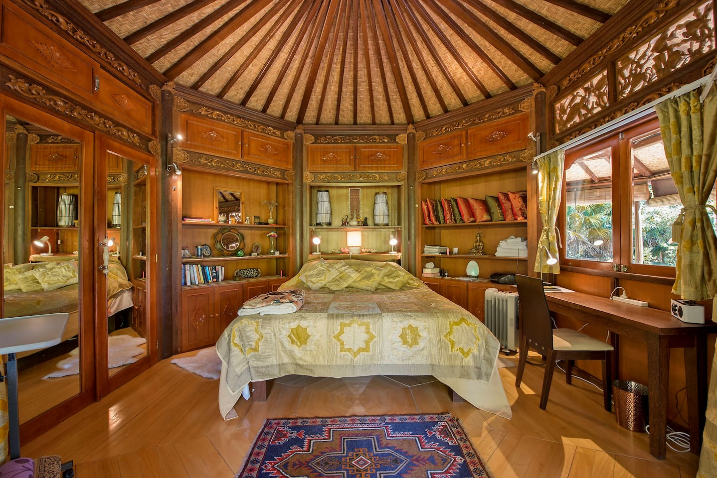 This is the bedroom made of carved wood and designed in Bali.