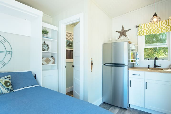 Pool house ensuite half bath, wet bar and full size beverage fridge with ice maker.