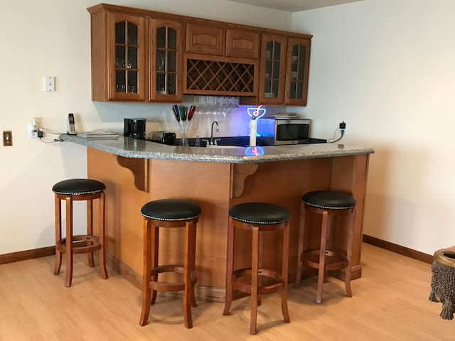 Kitchenette with microwave, refrigerator, coffee maker and wine chiller.  Seating for four at the bar.
