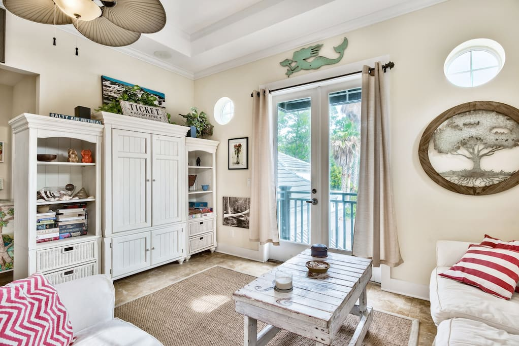 Living area with sleeper sofa/television/board games & french doors to enjoy the beautiful 30A breezes