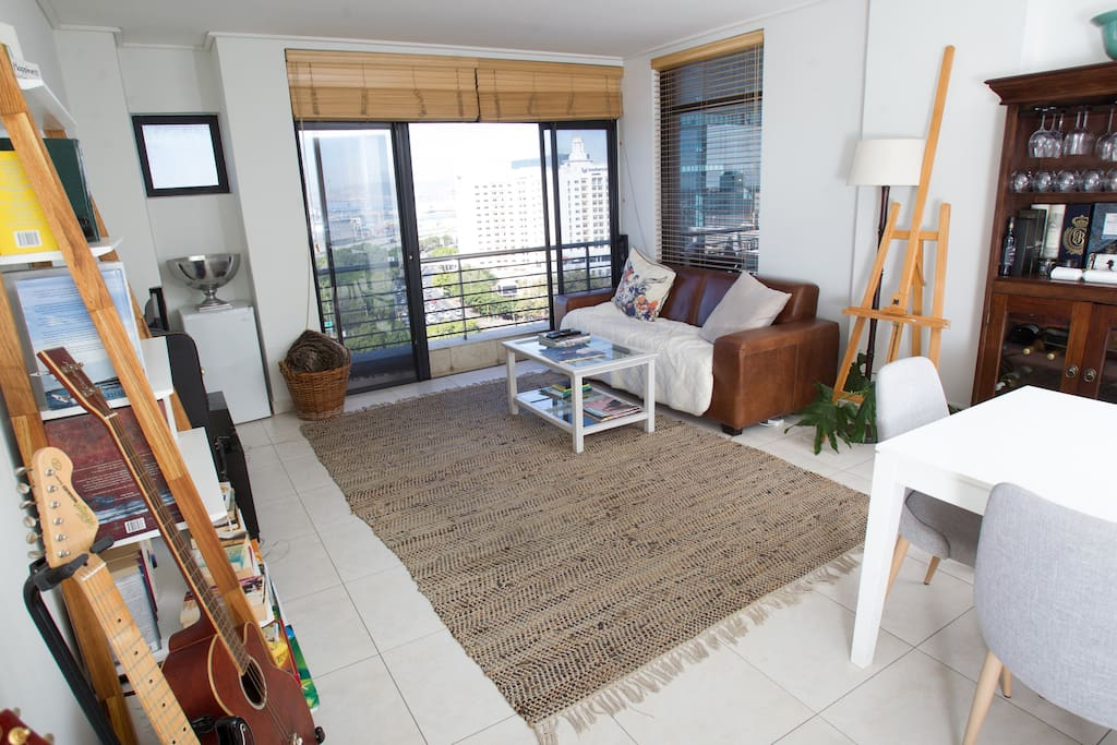 The lounge has space for hosting and gorgeous views towards the ocean and harbour
