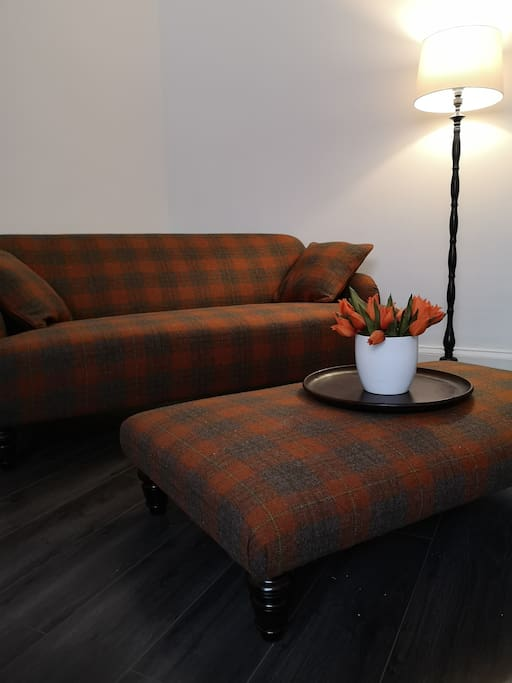Tweed sofa and foot stool in lounge