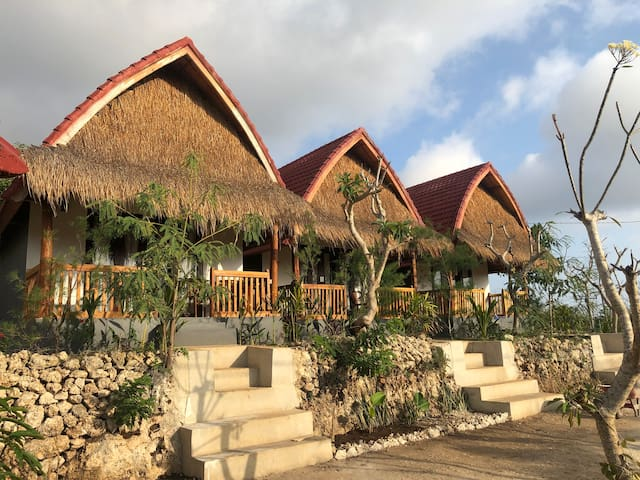 Thumb Garden bungalow is a serene in simplicity of tropical hideaway accommodation
