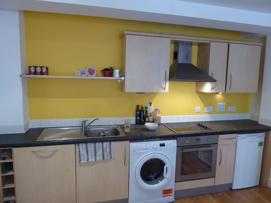 Modern kitchen to cook in, with fridge, freezer, dishwasher and washing machine.