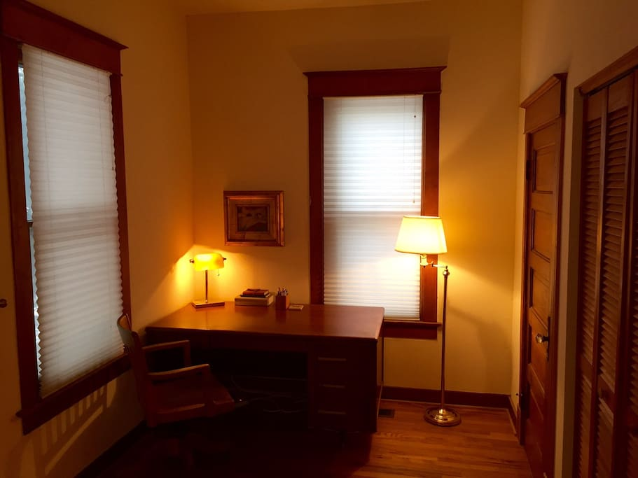 Office space with two closets are connected to the bedroom