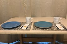 Dining table for guests to eat & drink. No food or drinks in the private room to prevent spills or other mess.