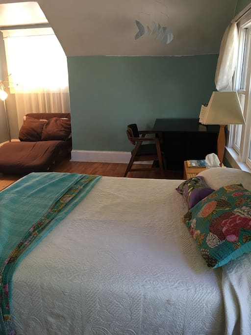 Spacious bedroom with full bed and twin futon.