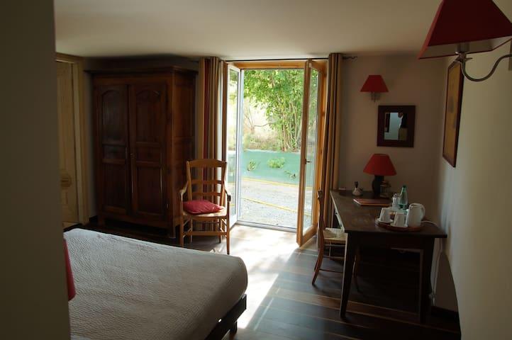 Porte fenêtre sur pré