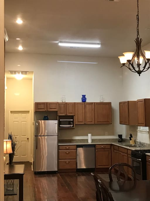Full size kitchen: Gas Stove, Refrigerator, microwave, coffee pot and dishwasher