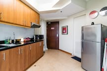 Kitchen is equipped for your basic cooking and dining. Rice cooker, coffee maker, percolator, microwave oven, and dining set for up to 8 persons.