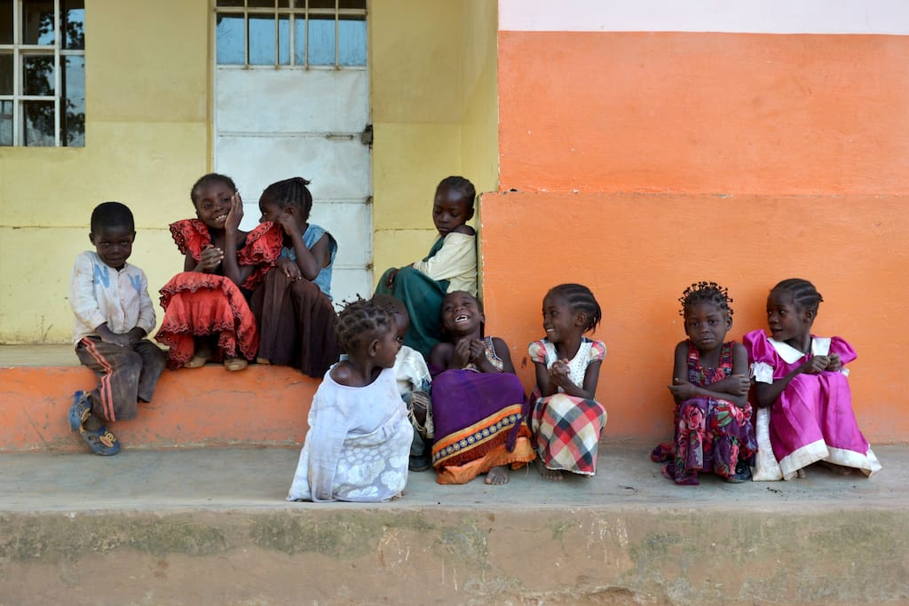 Sitting at Bumi's front porch: This is the family of children you will be guarding with your donation.