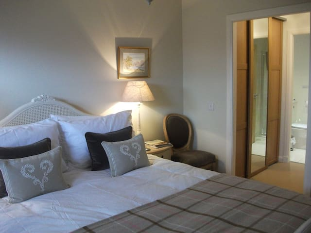 Double bedroom with dressing area and en-suite.  King size bed with luxury mattress topper.