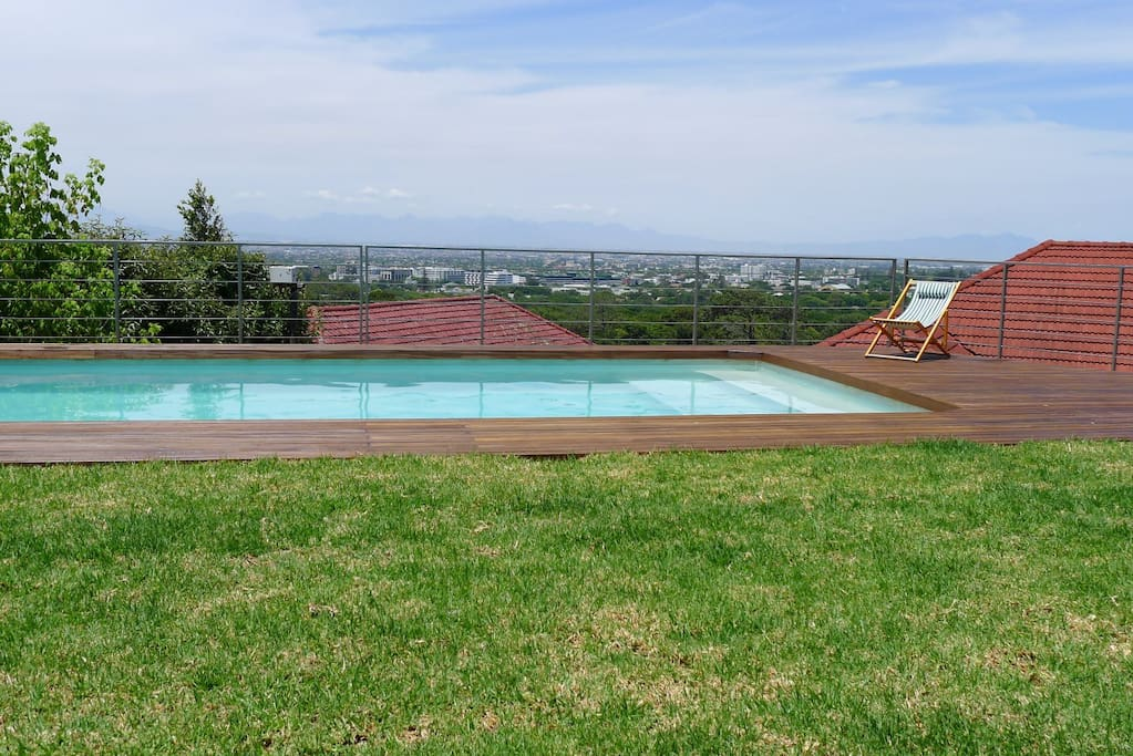 Swimming pool, wooden deck, view onto mountain range and False Bay