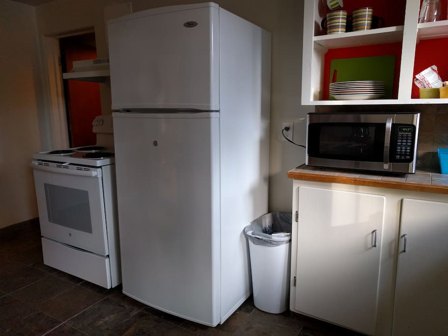 Full sized refrigerator, stove and microwave.