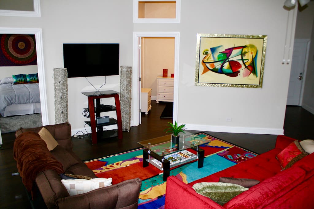Get comfy in our colorful mood elevating living room with cable and wifi