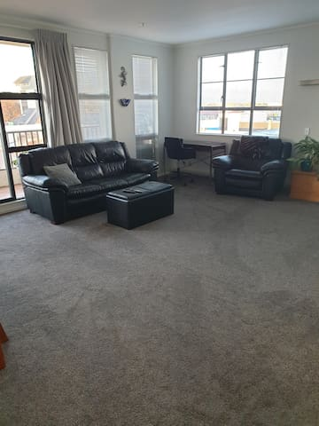 Spacious lounge with computer workstation with views down to Opiki