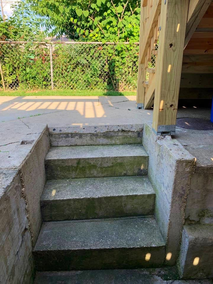 These stairs lead into the backyard from the shared backyard entrance with common area.