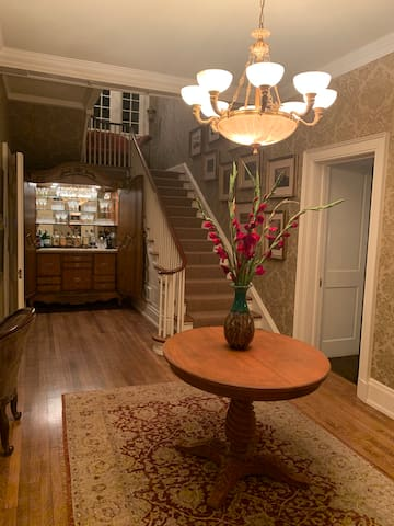 Entry Foyer with Bar Cabinet, main staircase