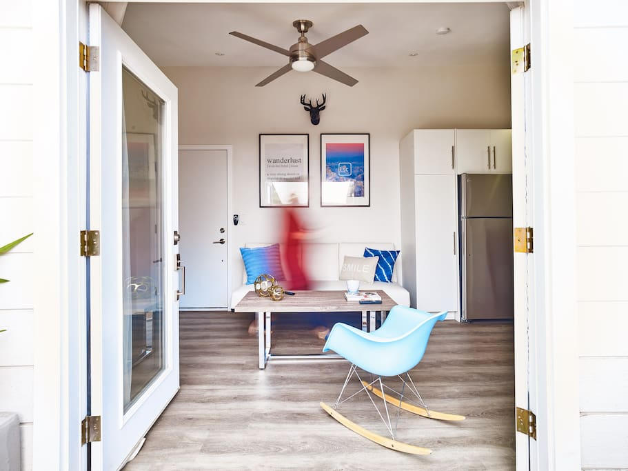 Photo was taken from the yard with the French doors open looking into living area. Ceiling fan in the living area and the bedroom.