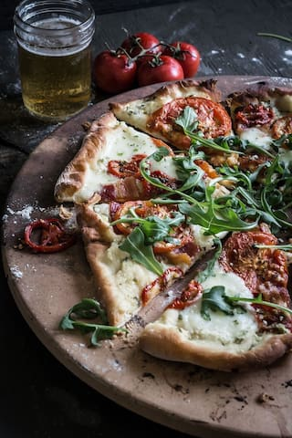 craft your very own wood fired pizza  all you bring is dough + toppings! In season we have tomatoes & fresh herbs