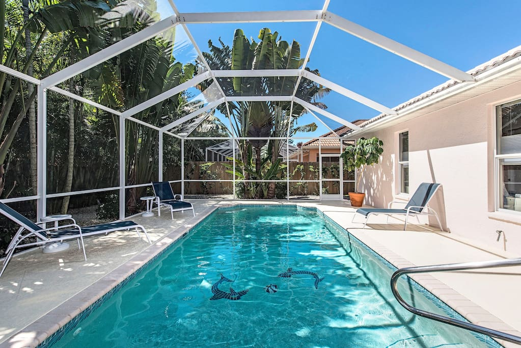 Screened large pool deck, professionally landscaped with chaise lounge seating