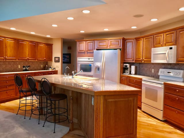 Kitchen island looking back into kitchen
