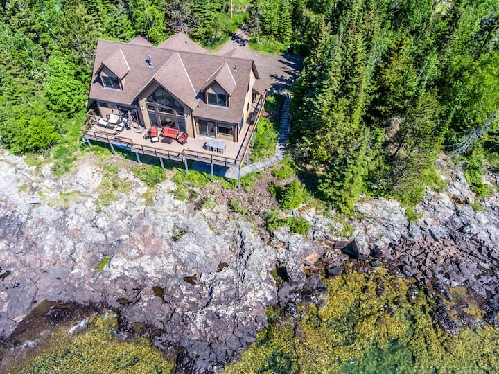 Serenity Shores  is a luxury vacation rental home located on the shores of Lake Superior near Grand Marais, Minn