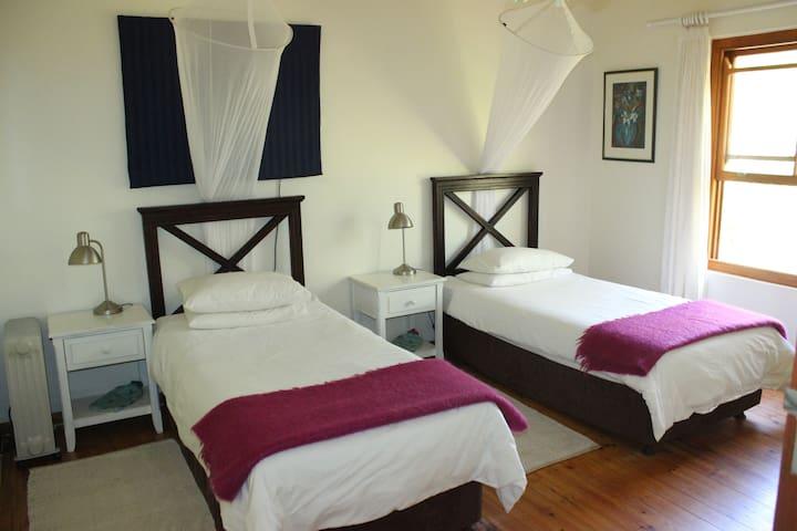 2 singles or king bed with en suite bath