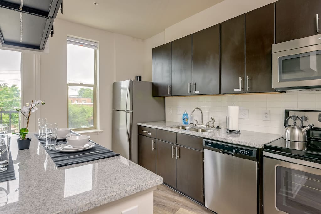 Large kitchen with Stainless Steel appliances to cook some delicious grub