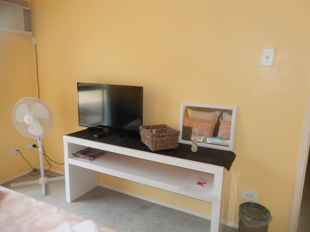 Bedroom 1 - Aircon, TV, fan, mirror.