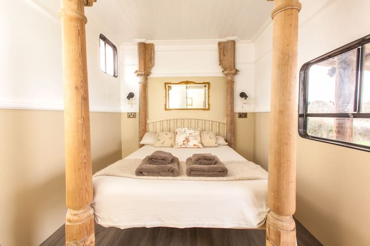 Relax into this four poster bed. The posts were saved from a church.