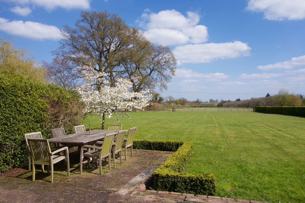 The view from the terrace of the spacious garden and surrounding fields