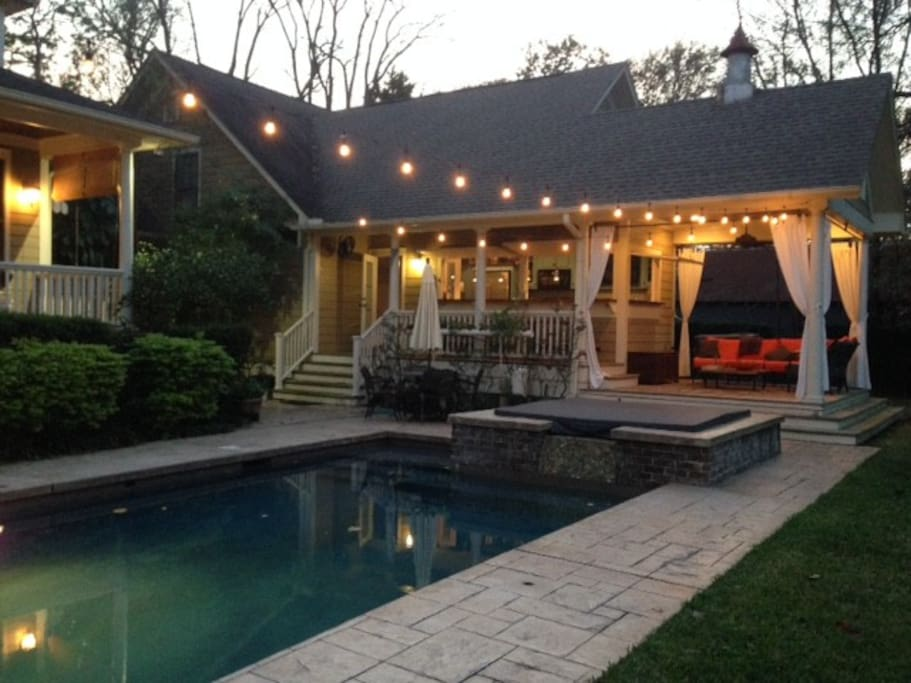 Outdoor kitchen, sitting area, hot tub and spa.