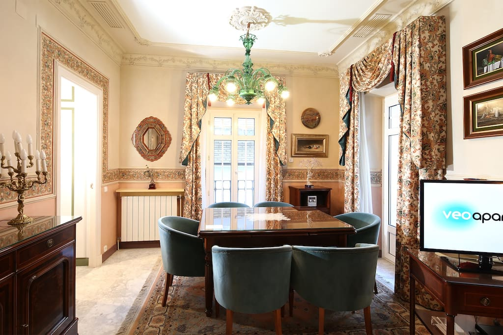 Dining area with table and 6 chairs.