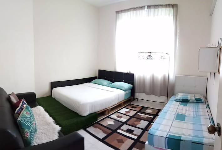 First bedroom, aircond, can accomodate for 4 guests