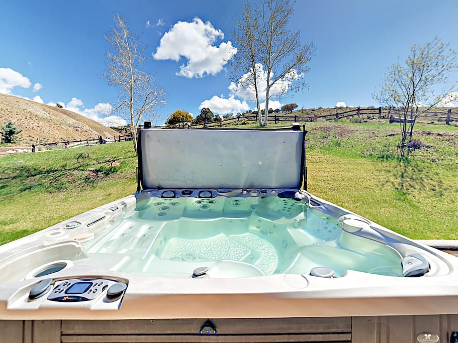 Soak in the private hot tub and take in views of the property.
