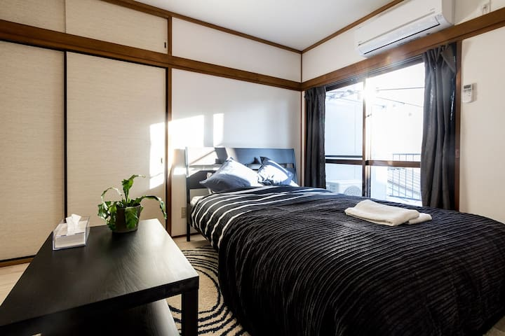 Double bed room connected to the kitchen, separated by folding doors