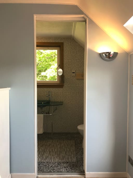 Behind the full length mirror lies your ensuite
