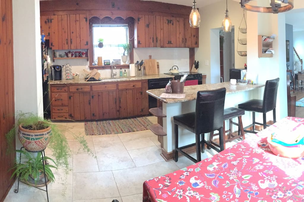 Open kitchen/dining area. Kitchen has dishwasher and Keurig, as well as tea kettle and a variety of teas available to guests.