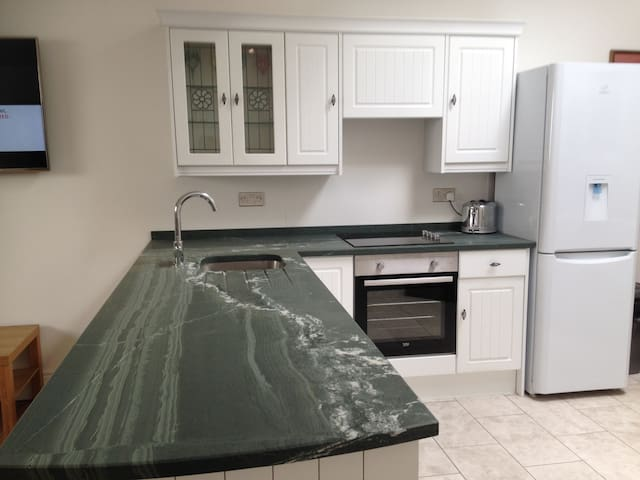 Kitchen  with solid slate work surface