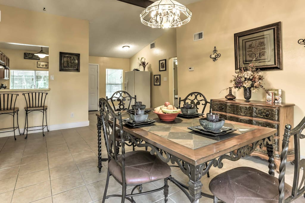 Sit at the beautiful dining room table, set for 4, and enjoy an appetizing meal.