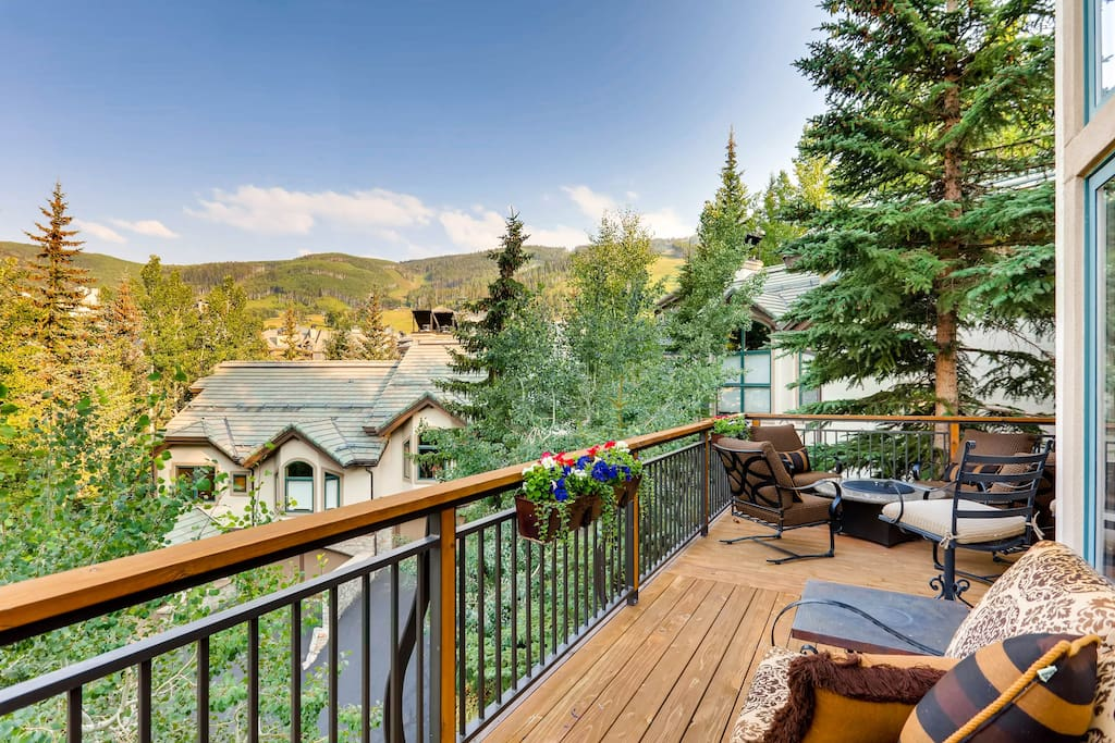 Lounge on the deck with a crisp beverage and take in mesmerizing mountain views.